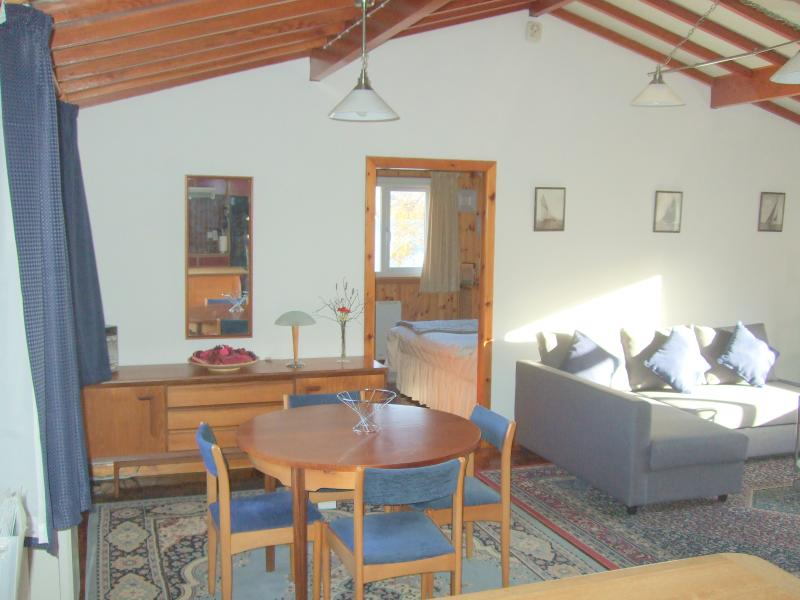 Relaxing Open Plan Living/ Dining Area with Danish Style Beamed Roof.