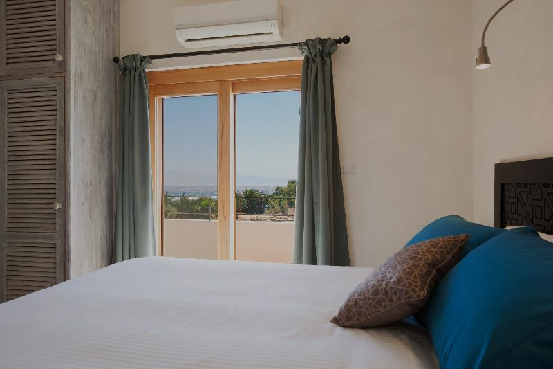 Master Bedroom featuring a spacious en-suite and a balcony with sea views