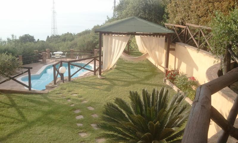 Garden with gazebo over the pool