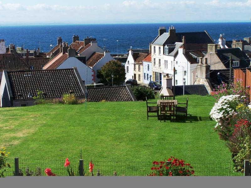 Shared garden with sea views, herb garden and BBQ.