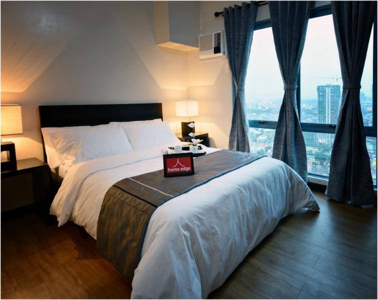 The Master's bedroom. Enjoy the splendid view of the city right from your bedroom.