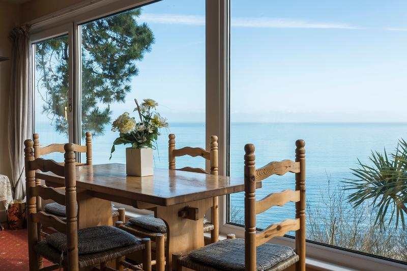 Dining table with sea view of St. Ives Bay and Carbis Bay Beach.
