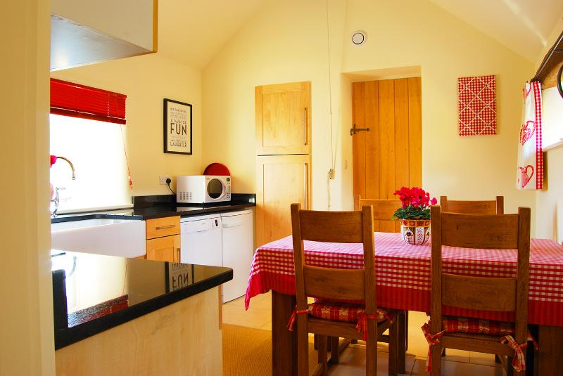 The Kitchen/Dining/Utility Room.