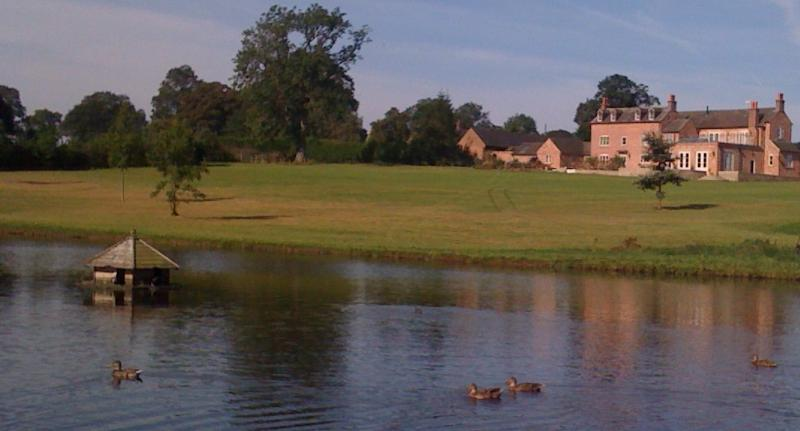 Rose Cottage at Hazelhurst Farm from across the lake.