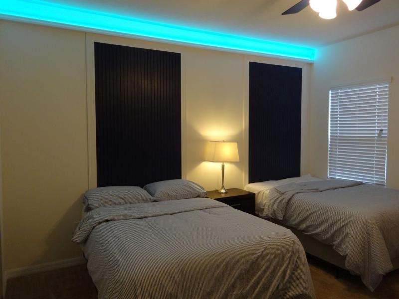 Boy Bedroom with 2 x Double bed, 42' TV, with personalise light changing colour above.