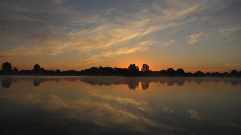 Sunrise across Somerford Lagoon (the lake Daisy Chain is next to)