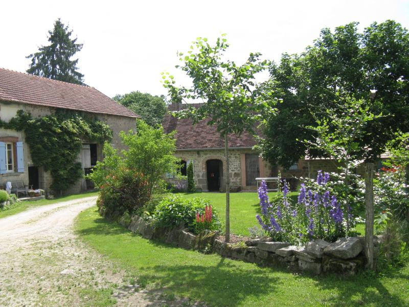 Le Gite au Chez with its' garden in front. The drive way to the left comes into the cul de sac