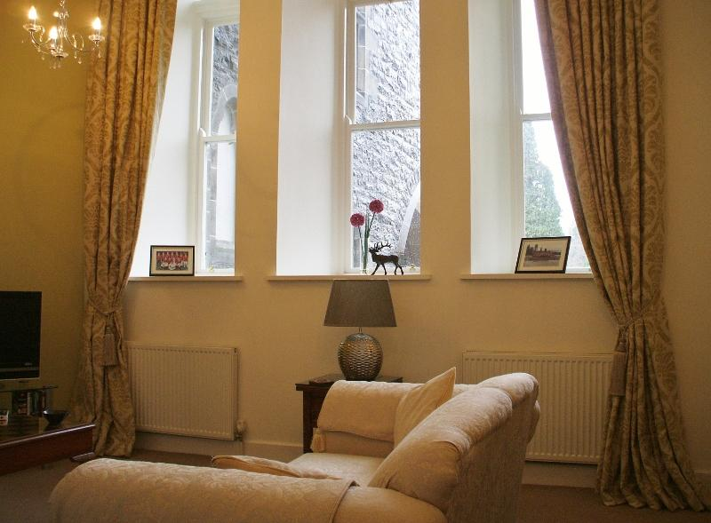 Lounge with Original high windows