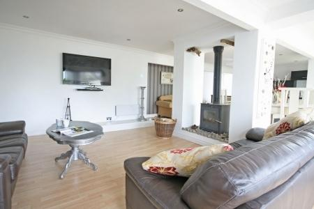 Large spacious open living with log burner and 50 inch plasma
