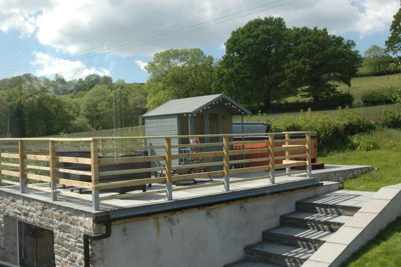 Hot Tub, Summer House and Seating Area in the back garden