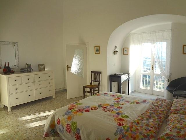 Bright main bedroom with balcony and ensuite.