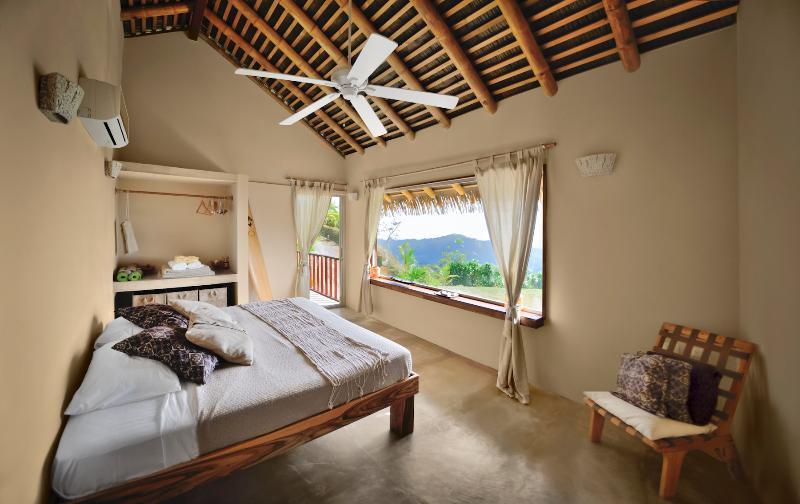 Contemporary  spacious master bedroom offers ocean views, sun-deck delightful en-suite bathroom