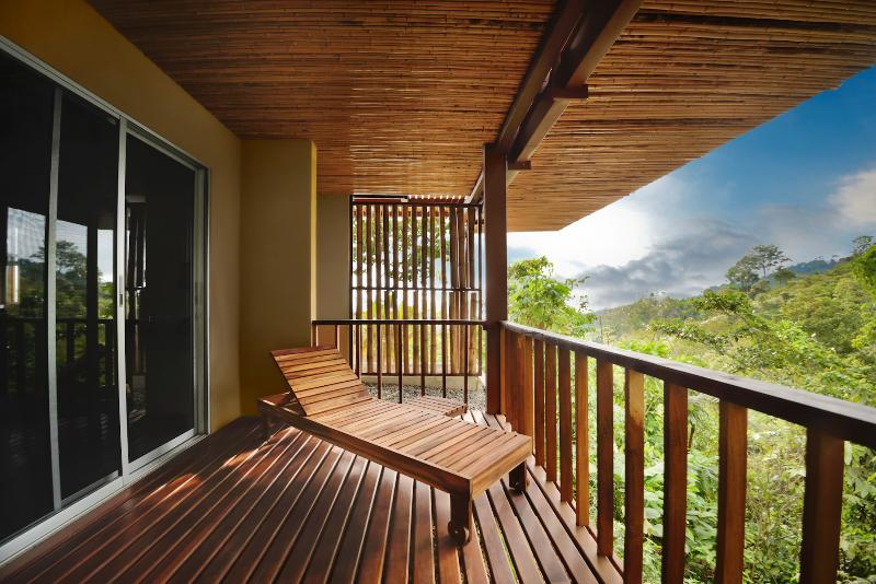 Jungle-view Suite has its own private deck overlooking the jungle canopy with all its nature
