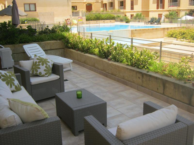 Own private terrace overlooking tranquil communal swimming pool