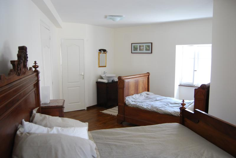 Gite bedroom with antique french oak beds