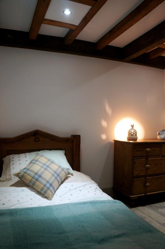 Single room with pitch pine bed.