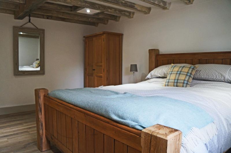 Luxury master bedroom with bespoke oak bed.