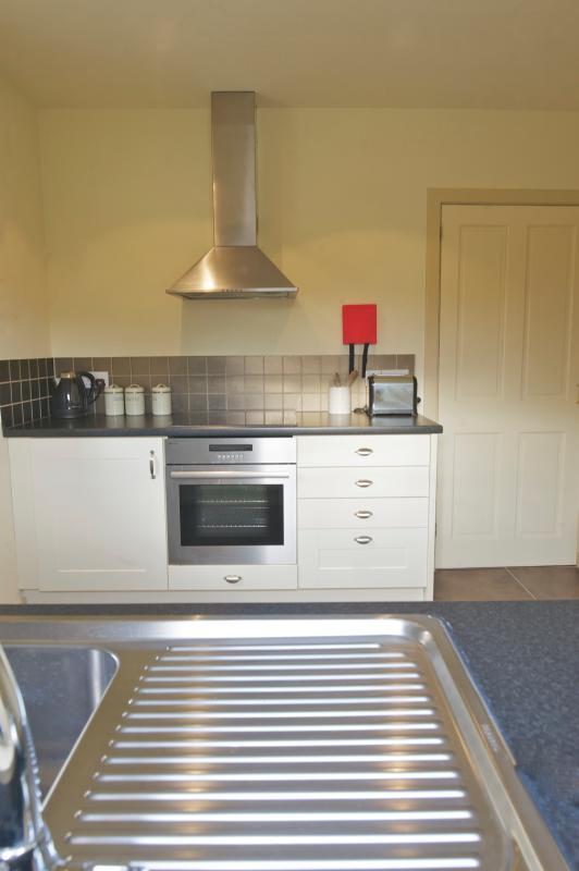 Crisp clean kitchen with underfloor heating