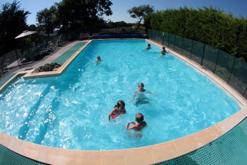 Large 12m x 6m secure fenced swimming pool with a safe shallow area for children