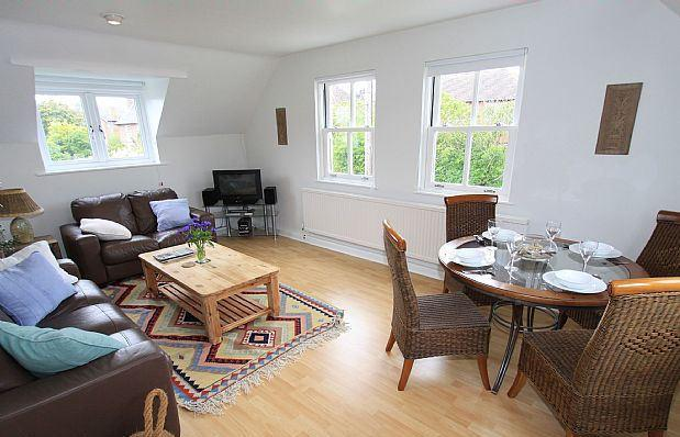 Spacious and airy Living and Dining Room with comfortable seating area for 5 and dining for 4