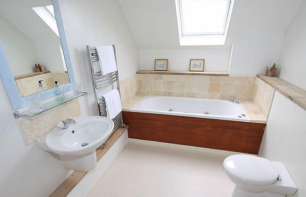 Bathroom with deep spa bath and separate tiled power shower area