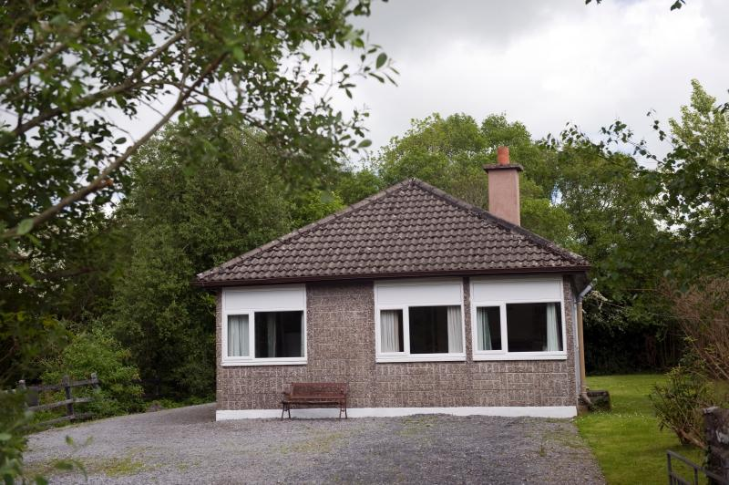 Lakeside a comfortable three bedroomed house with spacious lawn set in peacful, rural woodland area.