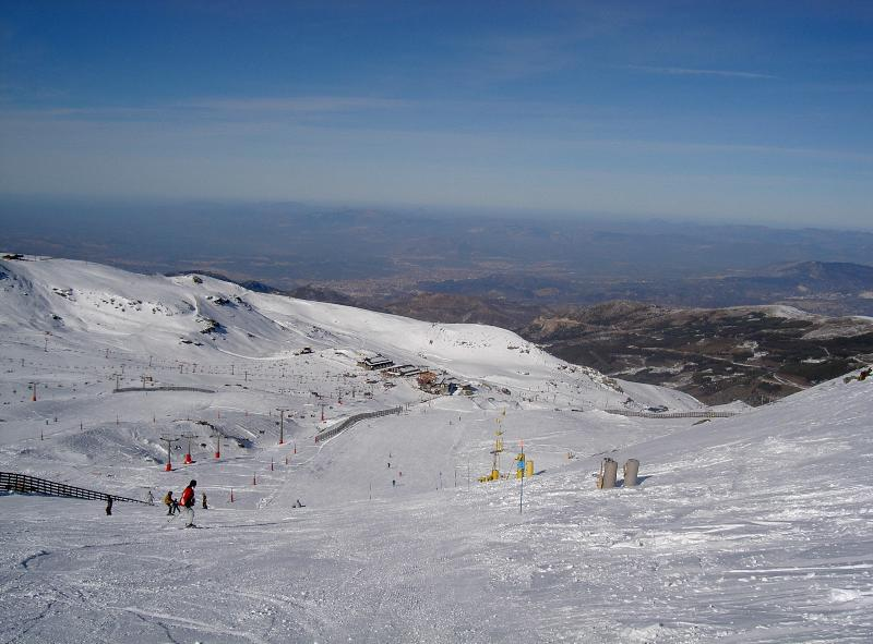 Sierra Nevada ski resort, invariably warm and sunny, and suitable for all levels, only an hour away