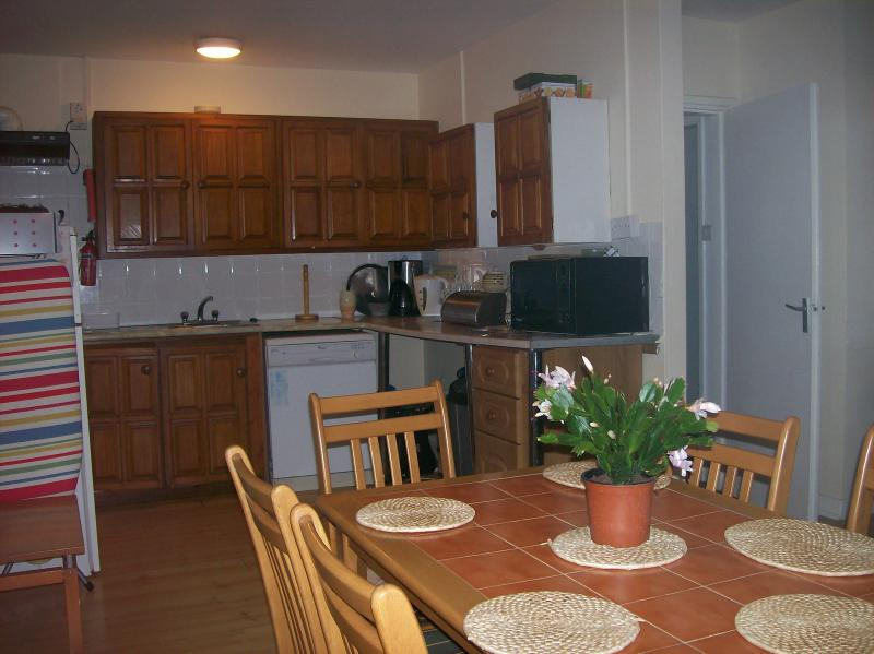 Another view of open plan dining room and fully equipped kitchen. including Microwave, Dishwasher.