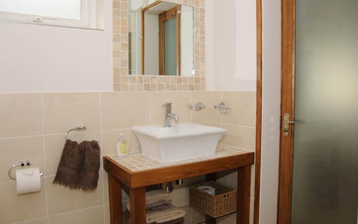 bathroom with separate shower and bath