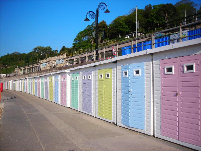 Beach huts on the prom at Lyme Regis just over two miles from The Retreat