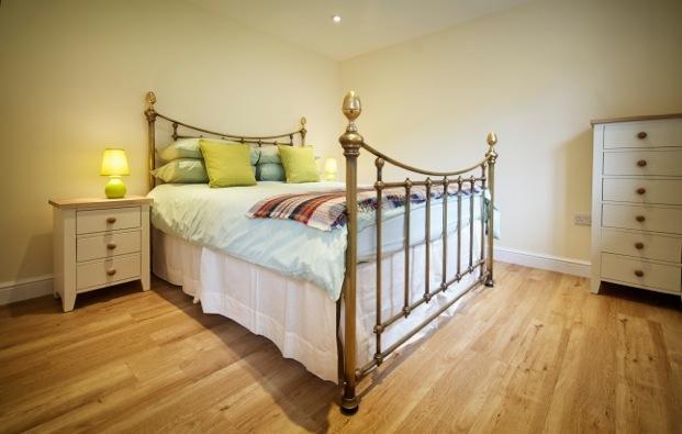 Brass Bed - overlooks gardens -  ensuite rainfall shower with underfloor heating.