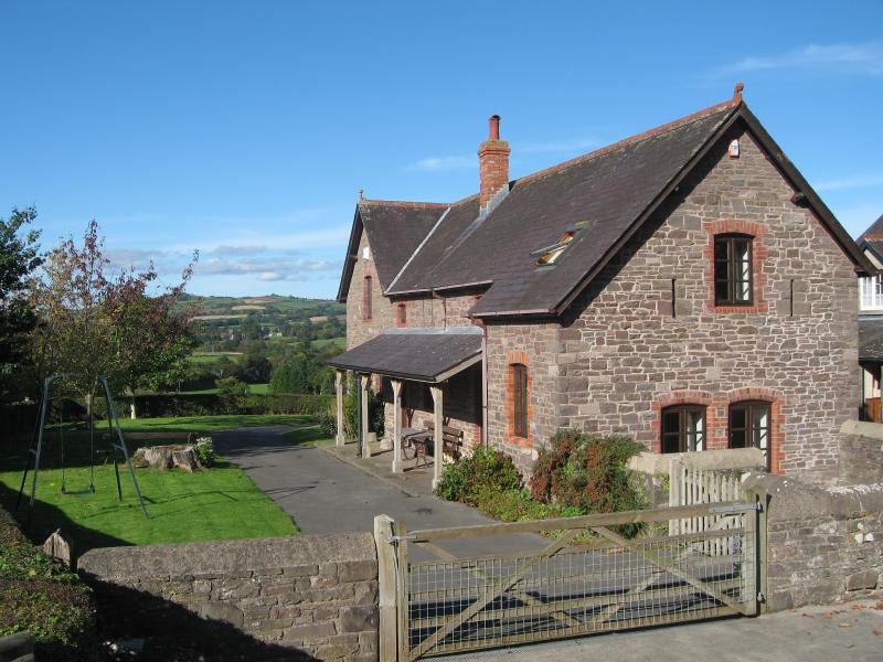 The cottage is a sympathetically restored barn, preserving the original feature stone walls & be