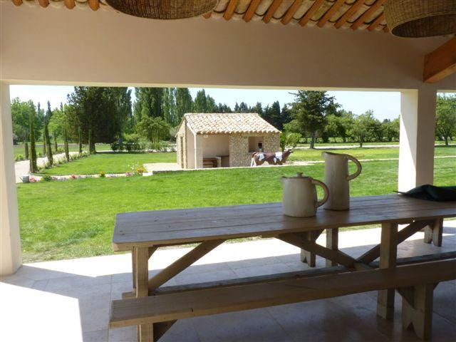 outside dining table and view on the BBQ cabanon anon