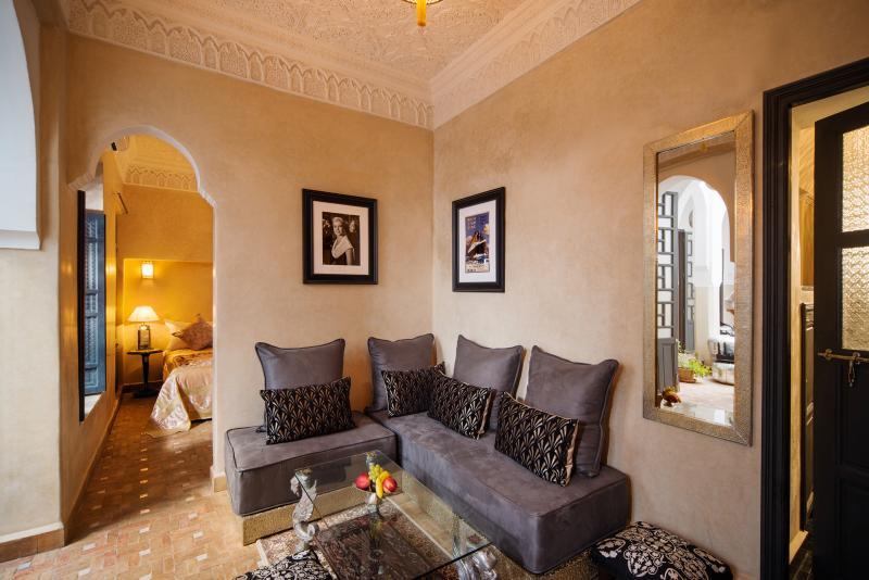 Charleston suite comprising bedroom area, sitting area and en suite.