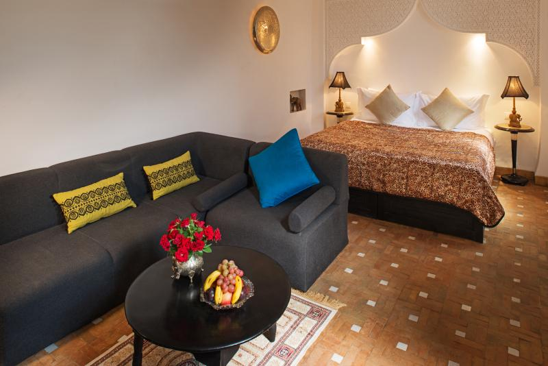 Chiquita suite with open fireplace and space to relax, and ensuite shower.