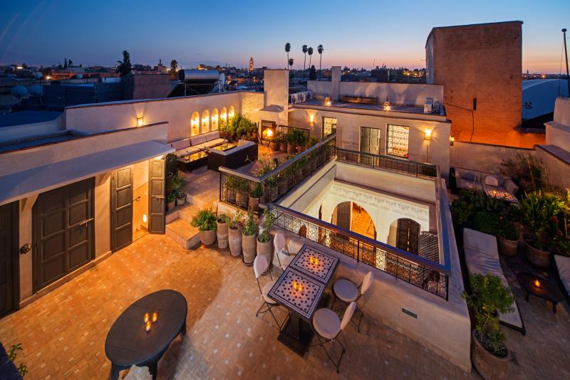 Private roof terrace with outdoor fireplace, space to relax and loungers to soak up the sun