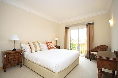 MASTER BEDROOM WITH BATHROOM ENSUITE THAT OPENS ONTA A SMALL BALCONY