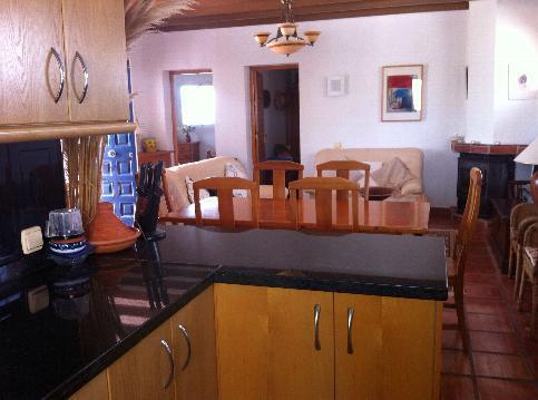 Open plan kitchen with microwave, gas oven, dishwasher, washing machine and fridge freezer.
