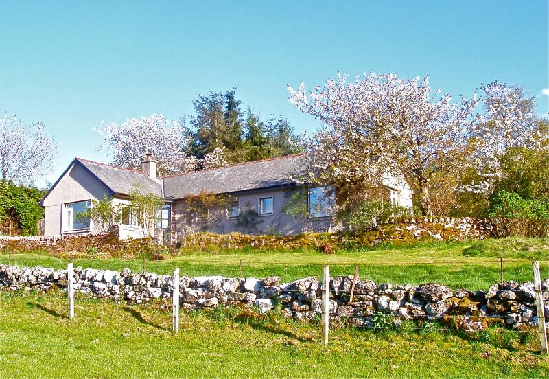 Garrique Cottage  surrounded by wild cherry trees in May.
