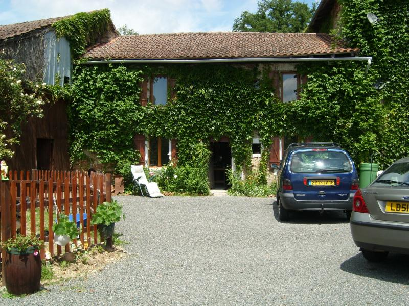 The cottage is attached to our main house on 2 acres of land & orchards