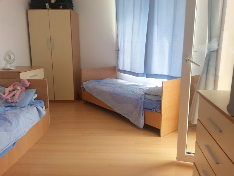 The second bedroom with 2 big single beds