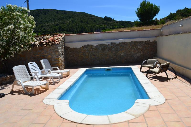 Private pool in walled courtyard with sun loungers to soak up the sun in perfect peace
