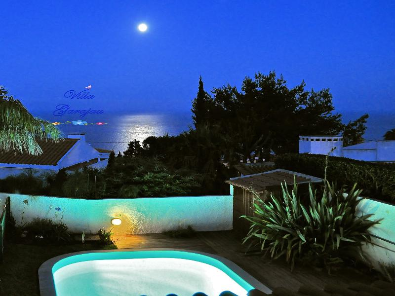Stunning ocean views from upstairs bedrooms at twilight.