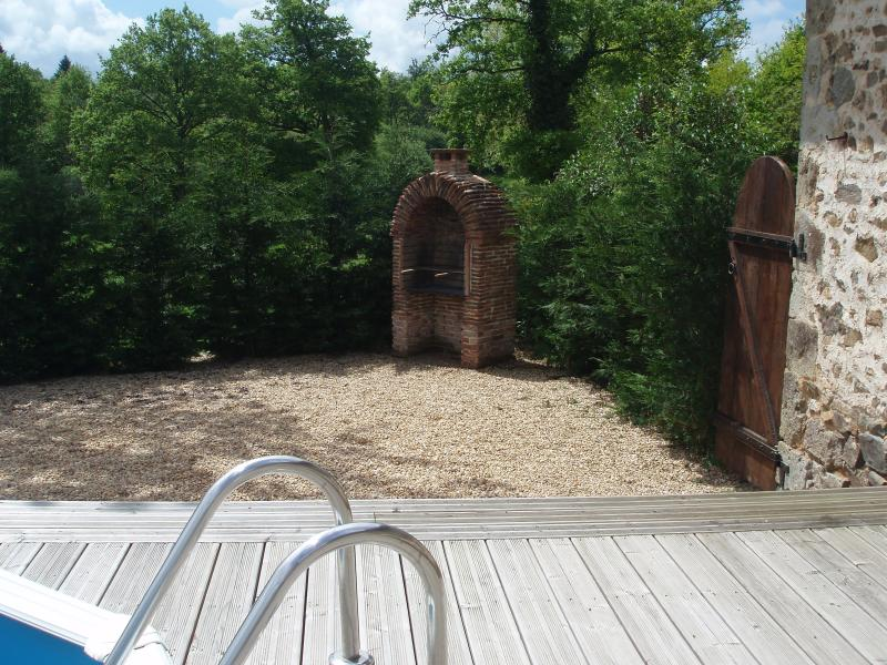 Decking and BBQ area next to the pool with outstanding views, enclosed garden
