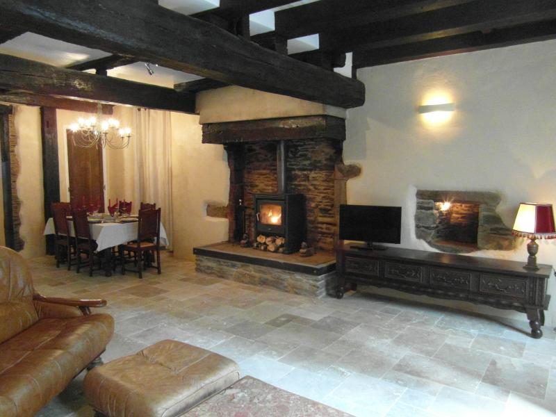 Relax in and enjoy the spacious lounge and dining room with wood burning stove