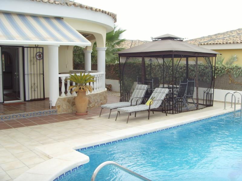 Private villa with large pool, perfect for families.  Shaded pergola for alfresco dining.
