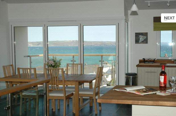 Open plan top floor kitchen / dining / sitting room with panoramic sea views