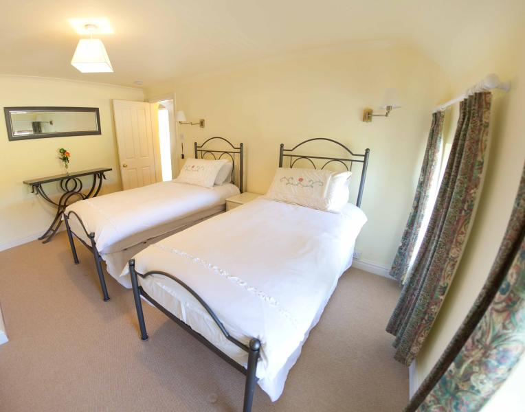 Bedroom number 1 with 2 single beds. Can be joined to be 1 Kingsize by previous request.