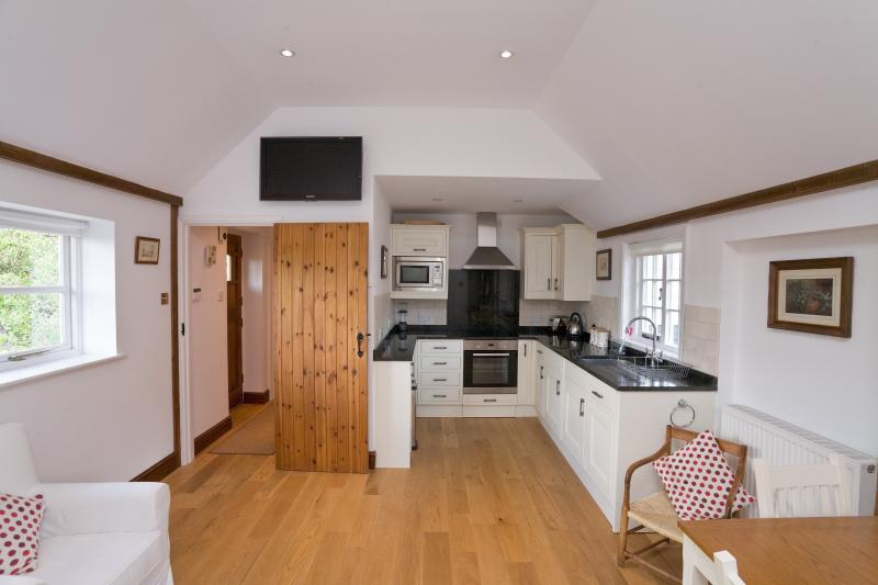 Beautifully equipped kitchen with TV on the wall