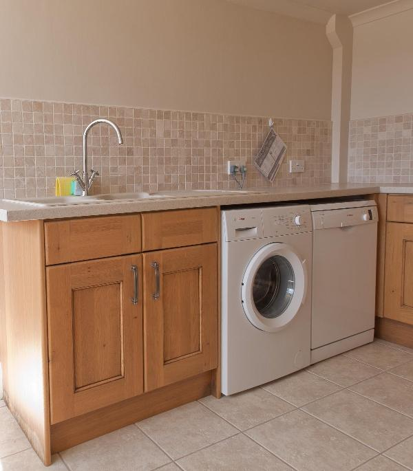 Utility room with Bosch washer and dishwasher.